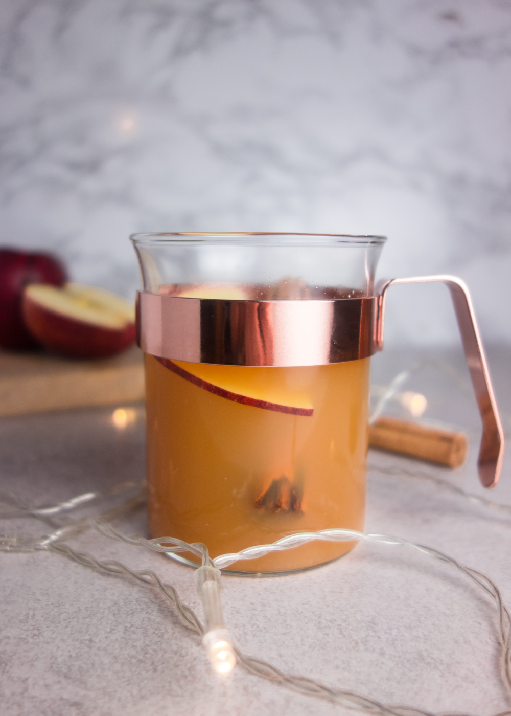 This warm apple Pimms recipe is spiced with orange and cinnamon to create the perfect winter warmer take on Pimms!