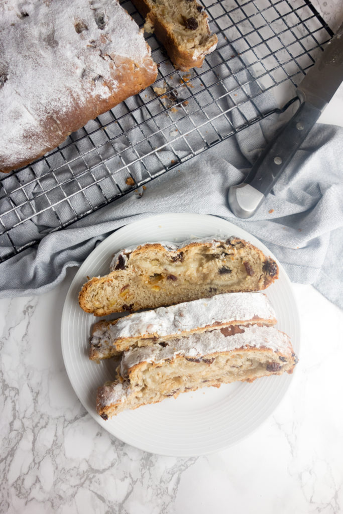 Homemade Christmas Stollen: A sweet bread enriched with butter, eggs, dried fruit and almonds, wrapped around marzipan and dusted with icing sugar!