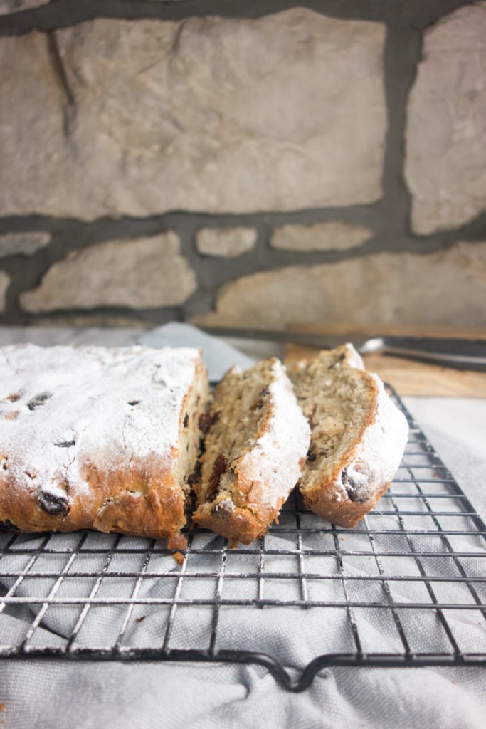 Homemade Christmas Stollen recipe: A sweet bread enriched with butter, eggs, dried fruit and almonds, wrapped around marzipan and dusted with icing sugar. SO good!