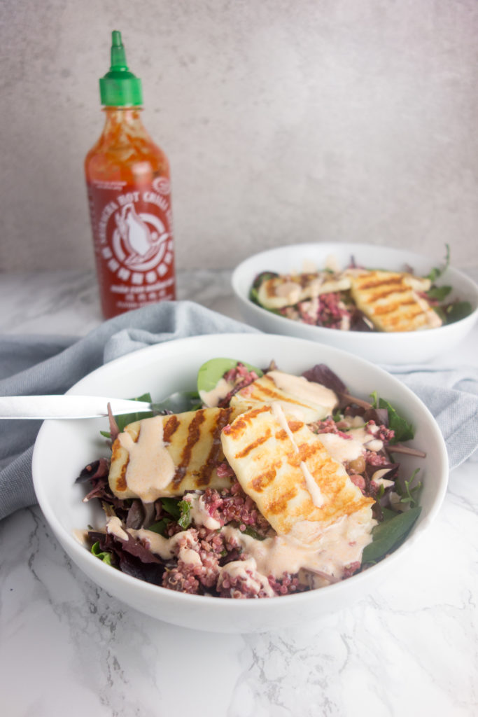 Halloumi Grain Salad: A simple vegetarian recipe for a filling salad topped with salty halloumi & a creamy sriracha yoghurt dressing. So delicious!