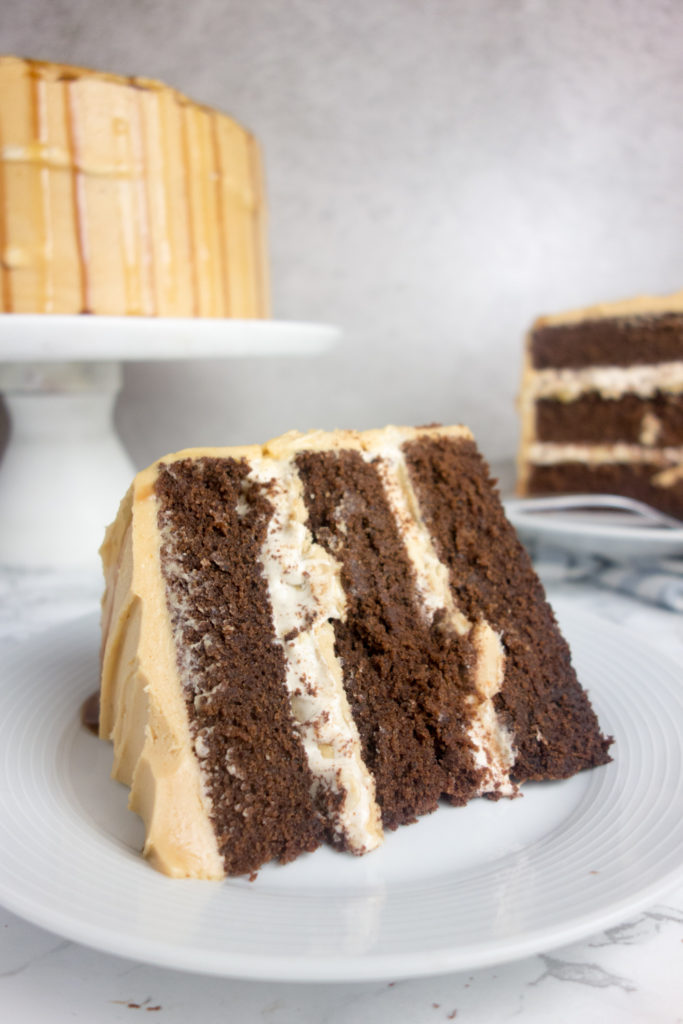 Snickers Birthday Cake recipe: Rich chocolate sponge filled with a thick layer of nougat and salted caramel, topped with creamy peanut butter frosting. Yum!