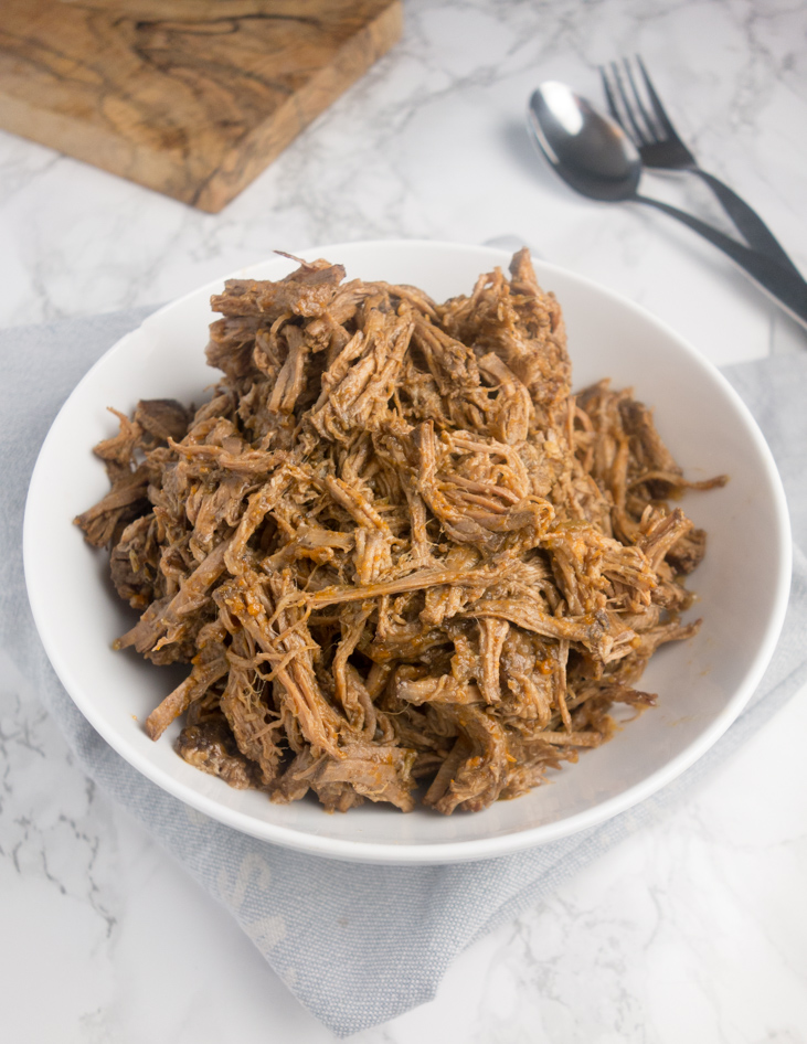 An easy recipe for tender barbacoa beef that's rich & smoky with a hint of spice from jalapenos. Delicious & perfect for feeding a crowd!