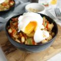 Rice & veg smothered in peanut butter, sriracha and soy sauce then topped with a perfectly poached egg - an easy recipe for spicy peanut rice!
