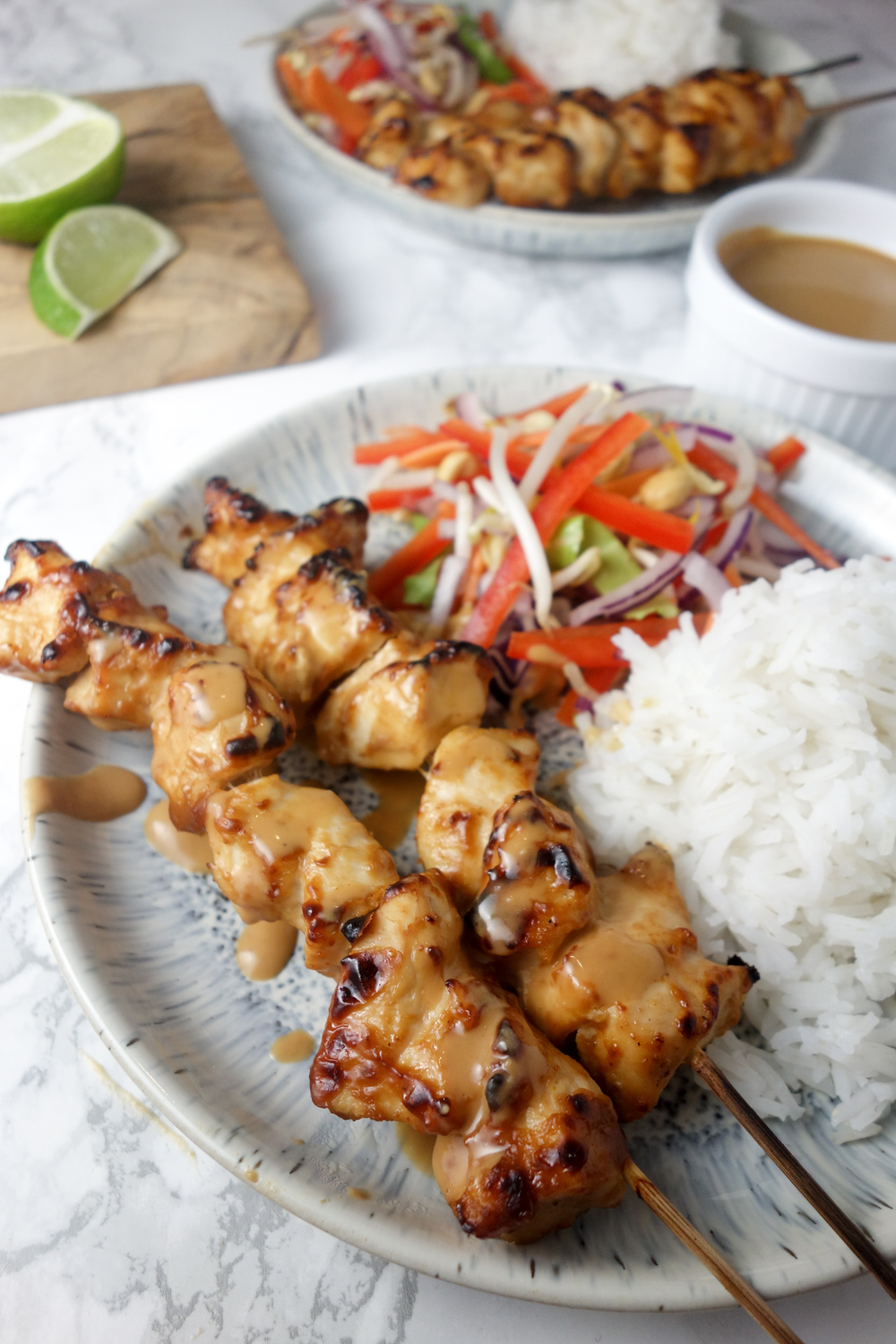 A quick & easy recipe for chicken satay skewers with a creamy, nutty peanut dipping sauce. SO tasty!