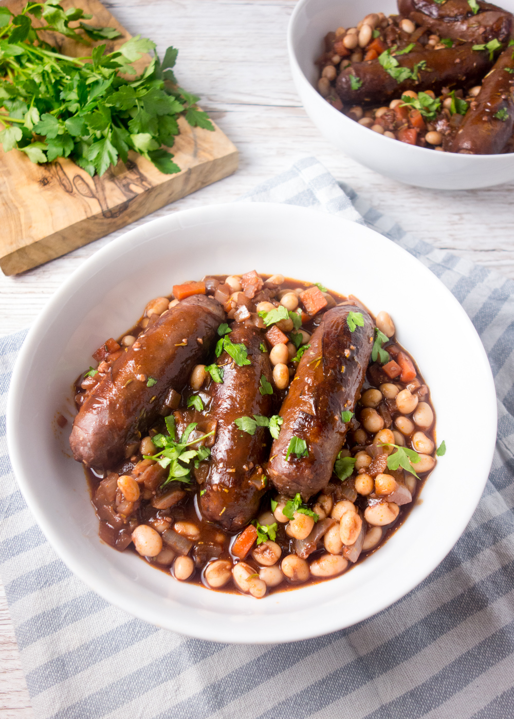 Vension Sausage Bean Casserole: A hearty, comforting recipe of venison sausages in a rich red wine gravy that only takes 20 minutes to cook.