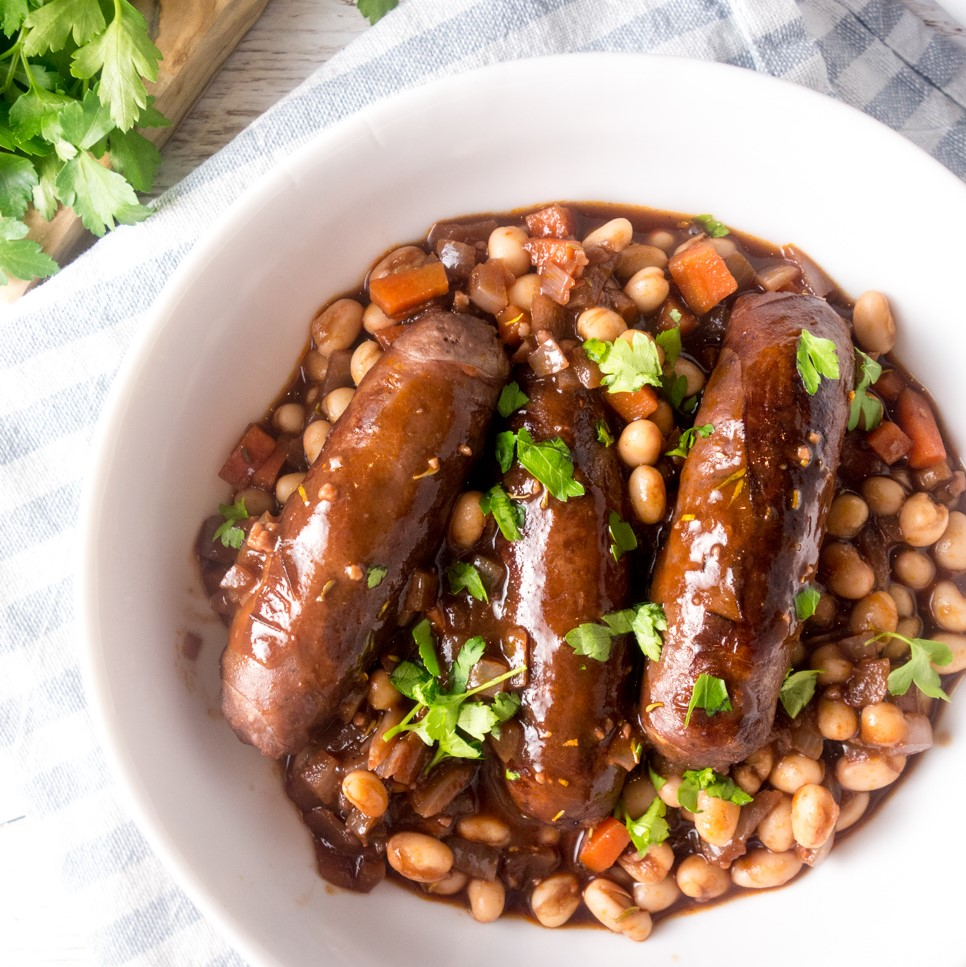 Venison Sausage Bean Casserole: A hearty, comforting recipe of venison sausages in a rich red wine gravy that only takes 20 minutes to cook.
